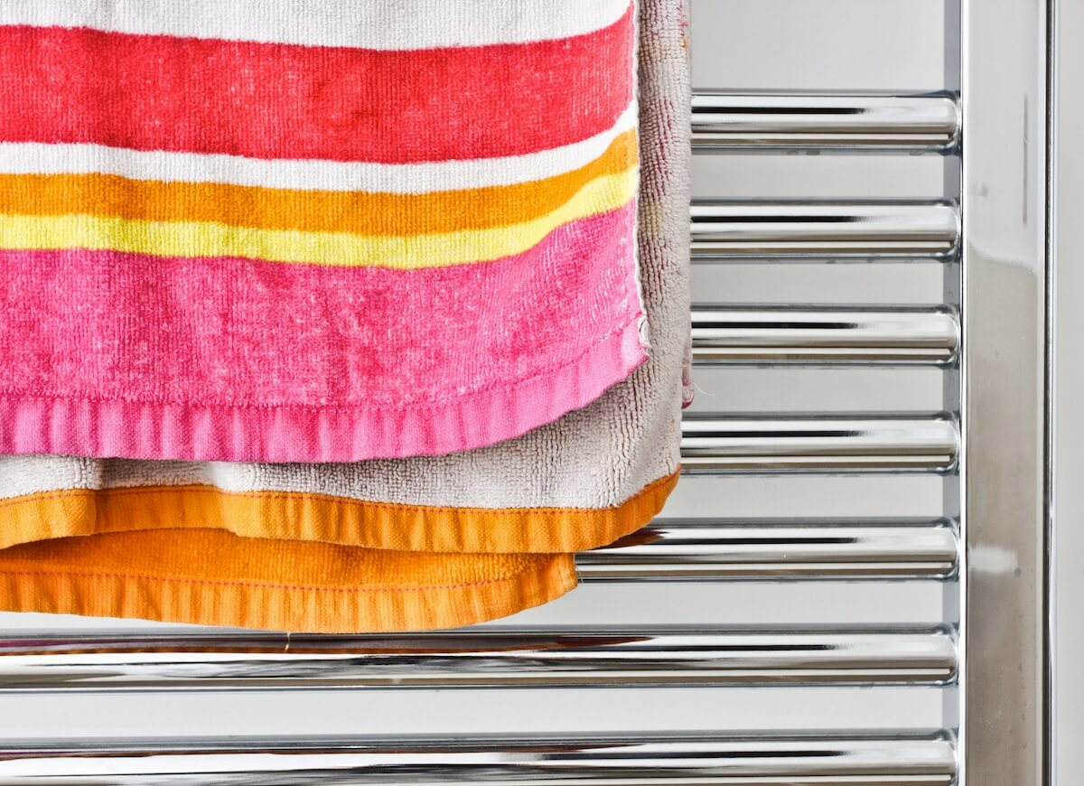 hanging wet clothes on towel warmers